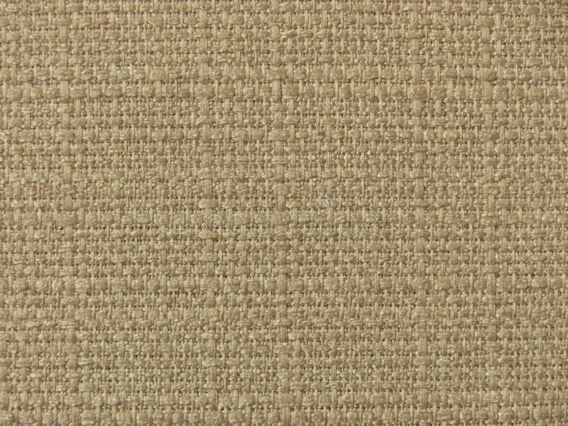 Canvas. Light fabric texture in beige tones. Suitable for backgrounds, wallpapers, cover. Light fabric texture in beige tones. Suitable for backgrounds stock images