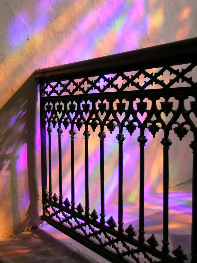 Light filters from a stainglass window in a church stock photos