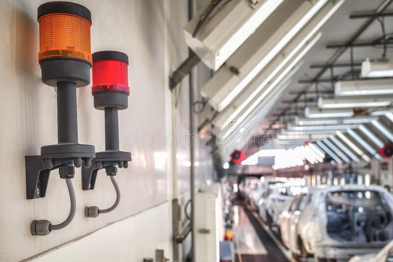 Light fire alarm system under the ceiling of the production room stock image