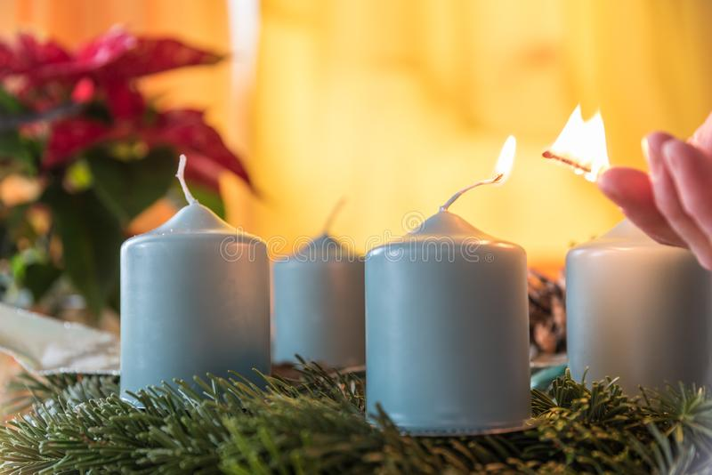 Light first Advent candle - close-up royalty free stock image