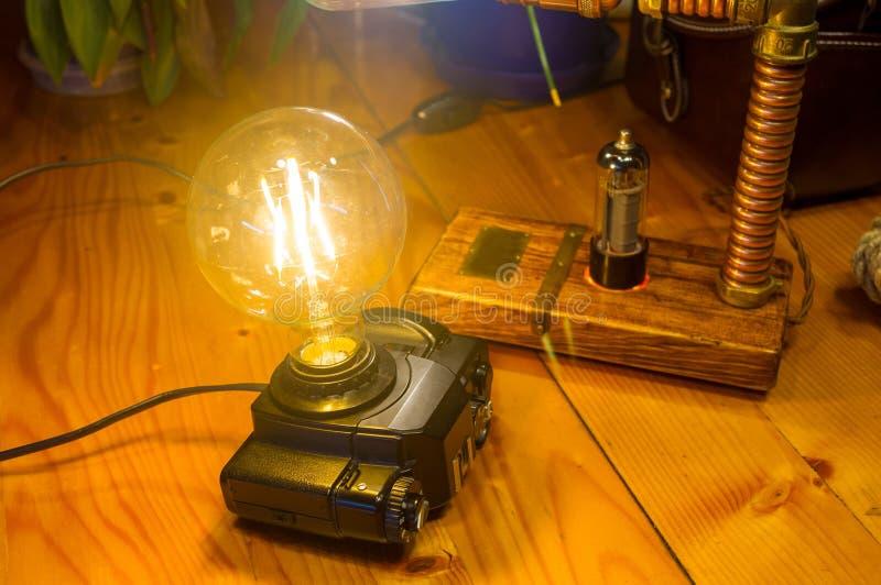 Light fixture handmade in vintage style, retro film SLR camera case. Led lamp royalty free stock photos