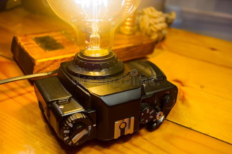 Light fixture handmade in vintage style, retro film SLR camera case. Led lamp stock image