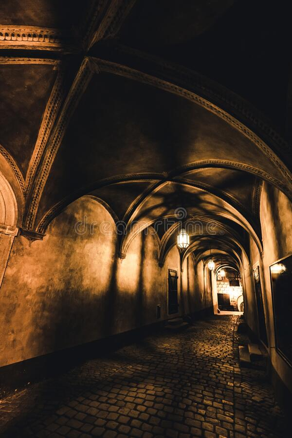 Free Light From The Lamp And The Shadows In The Mysterious Corridor In Old Dungeon Royalty Free Stock Images - 187071979