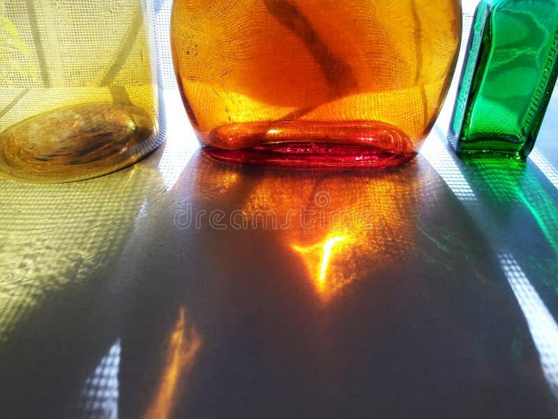 Light through glass bottles, colourful Bottles stock images