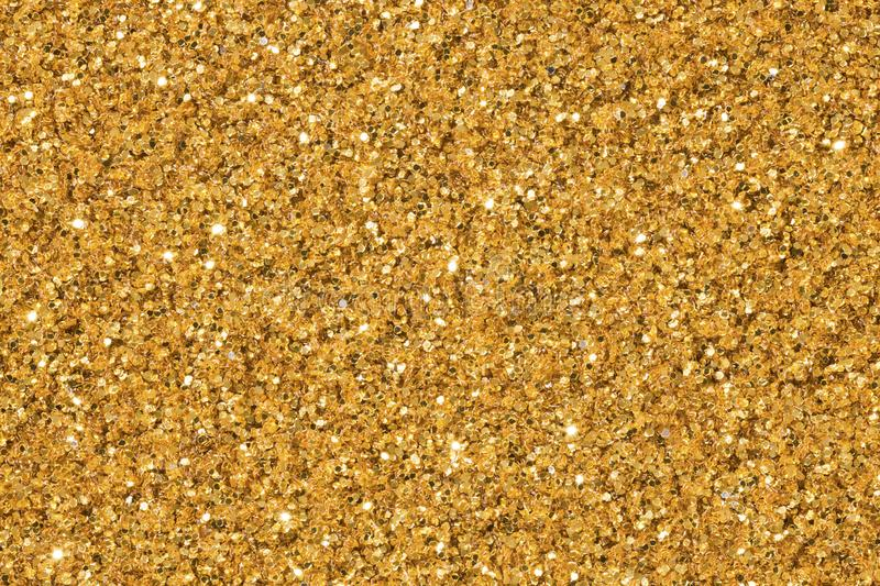 Light golden background with glitter. High quality texture in extremely high resolution. stock image