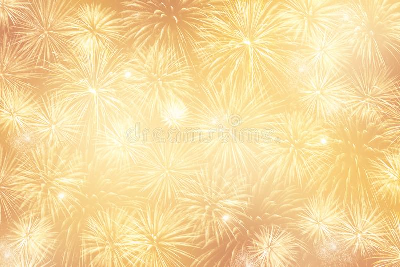 Light Golden festive background with lots of fireworks. Holiday and Christmas stock image