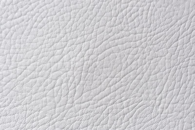 Light Gray Artificial Leather Texture. A macro shot of light gray artificial leather texture royalty free stock photos