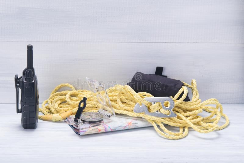 On light gray background, traveler set, walkie talkie, compass, map and rope stock images