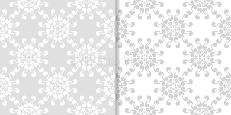 Light gray floral ornaments. Set of seamless patterns royalty free illustration