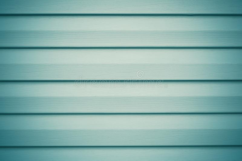 Light gray and green wood planks. Abstract blue background with metal horizontal stripes for decorative design. Wooden texture. royalty free stock photos