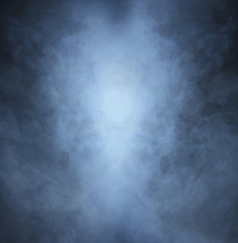 Light gray smoke on a black background. Halloween concept image
