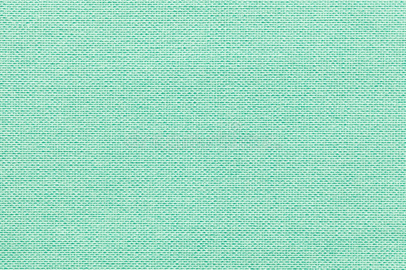 Light green background from a textile material with wicker pattern, closeup. stock photography