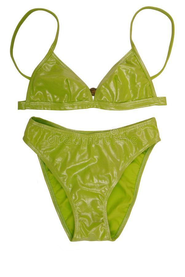 It is light green bathing suit. The female bathing suit is on white background. Isolated shine swimsuit as a single object. A royalty free stock images