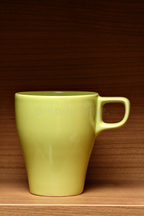 Download Light Green Coffee Cup On Wooden Shelf Stock Photography - Image: 13493912