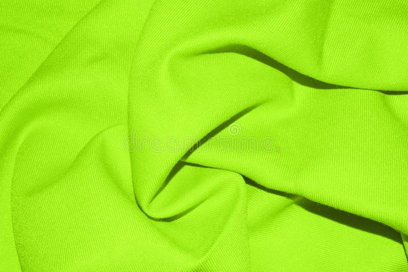 Light green fabric background with pleats. stock photography