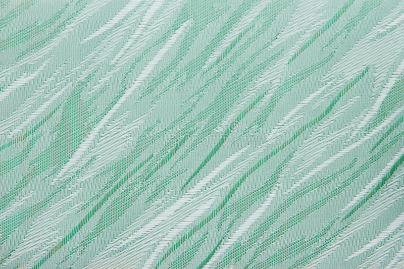 Light green Fabric blind curtain texture background. Can use for backdrop or cover royalty free stock image