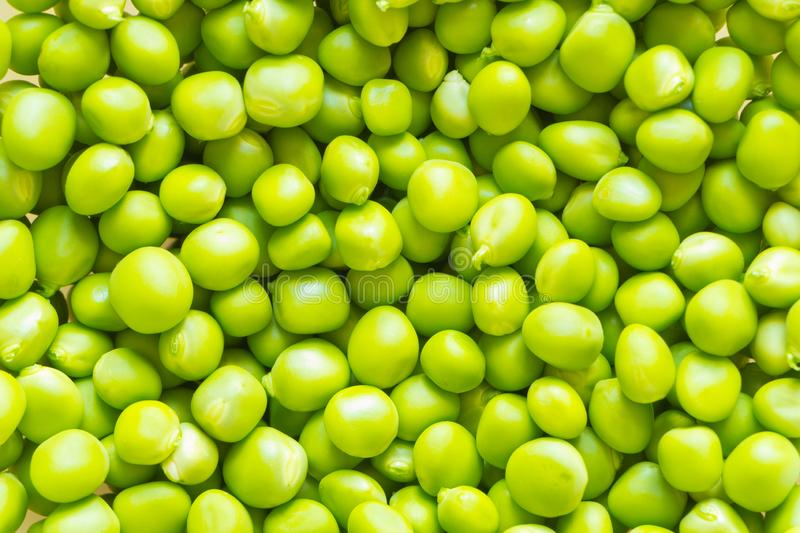 Light-green fresh peas peeled from pods. Background. royalty free stock images