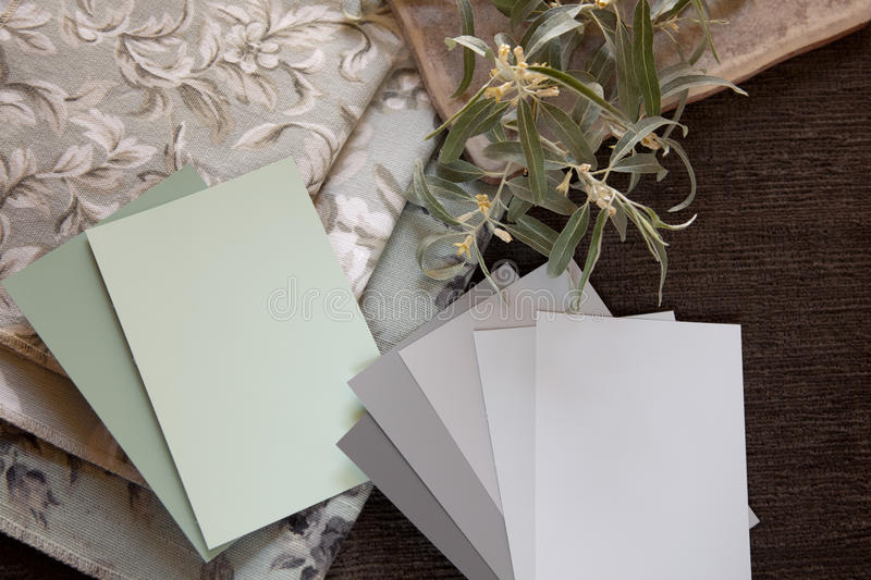 Light green and neutral swatches. Light green and neutral gray paint color and fabric swatches with a tile stock photos