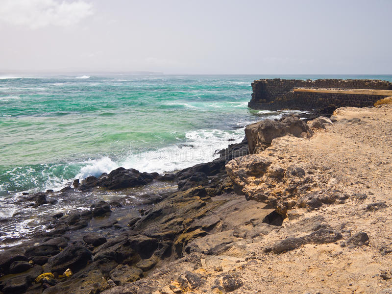 Download Light Green Ocean Surf And Rocky Shore Stock Photo - Image: 26001724