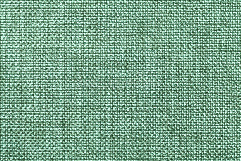 Light green textile background closeup. Structure of the fabric macro royalty free stock photos