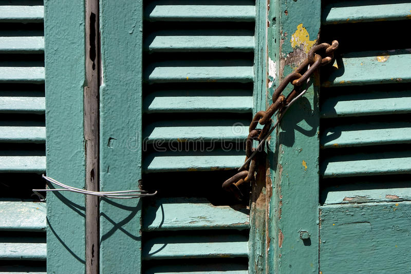 Venetian blind and a rusty chain in la boca stock image