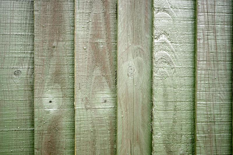 Light green wooden fence background. Close up stock photo