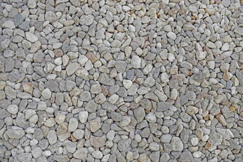 Light grey small pebble. stock photography