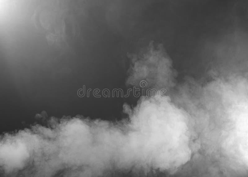 Light Grey Smoke Texture. Clouds of white/grey smoke floating near the ground on grey background stock photo