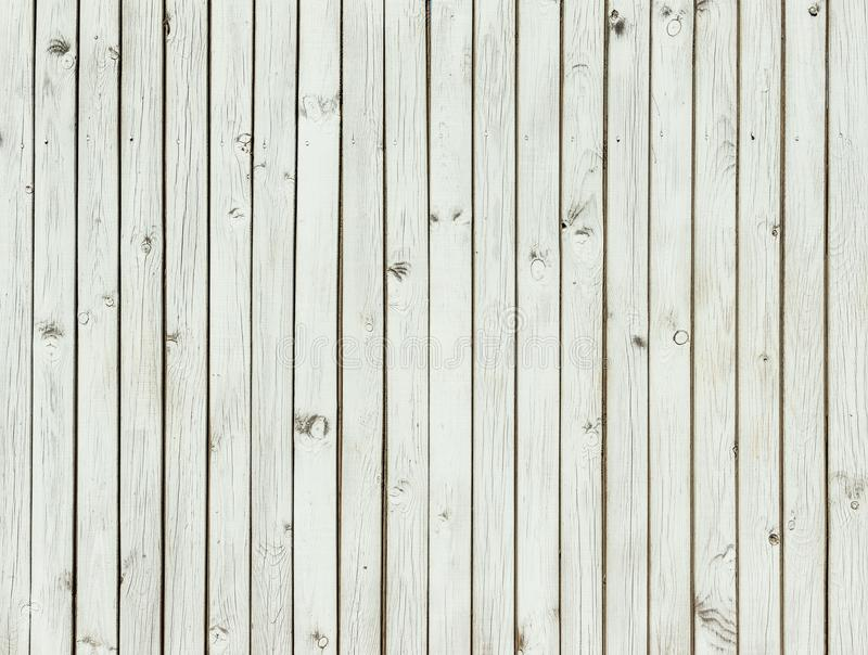 Light grey wood texture, painted grey planks. Fence boards, background royalty free stock photos
