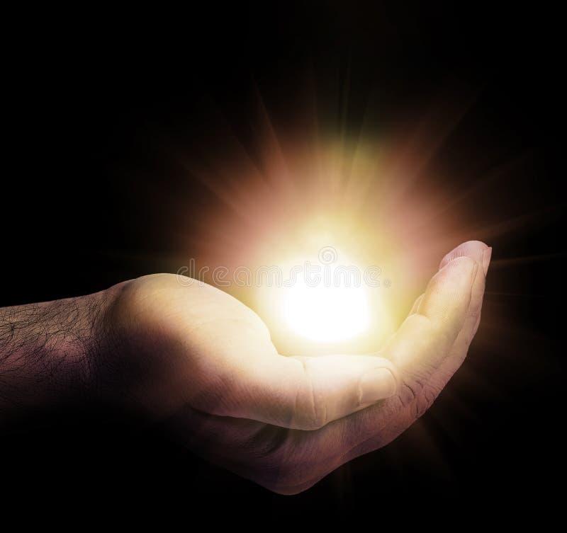 Light On A Hand Stock Photo