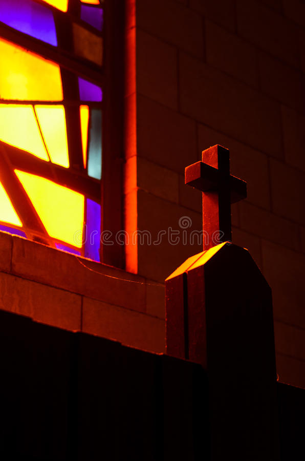Light on the holy cross. Stained glass window casting light on the holy cross stock photo