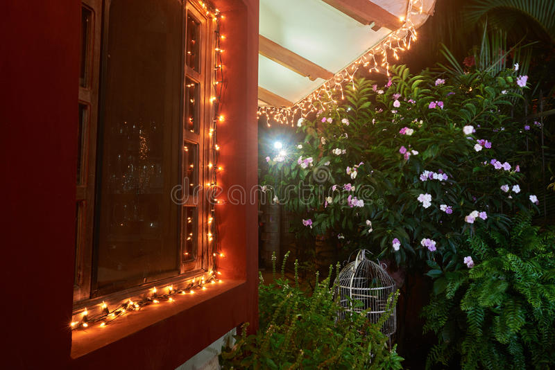Light on house in christmas time. In tropics at night stock image
