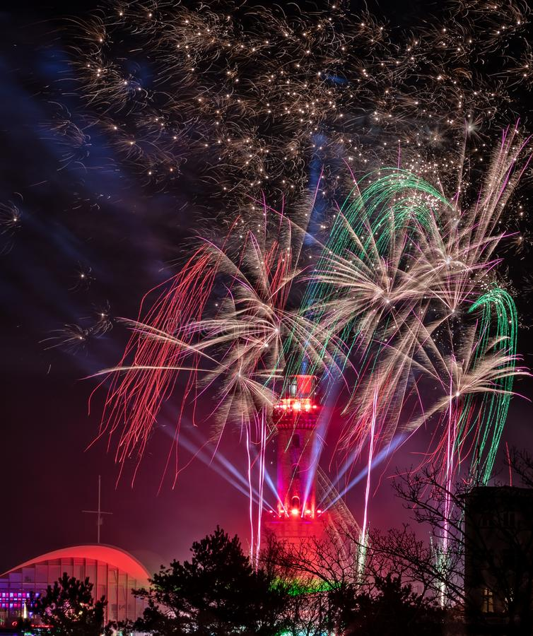 Light house with fireworks royalty free stock photo