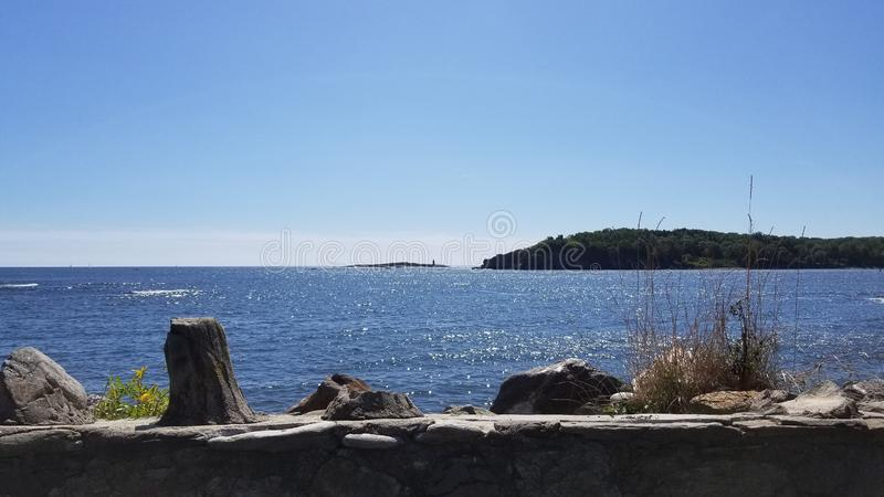 A light house off in the distance from peaks island royalty free stock photo