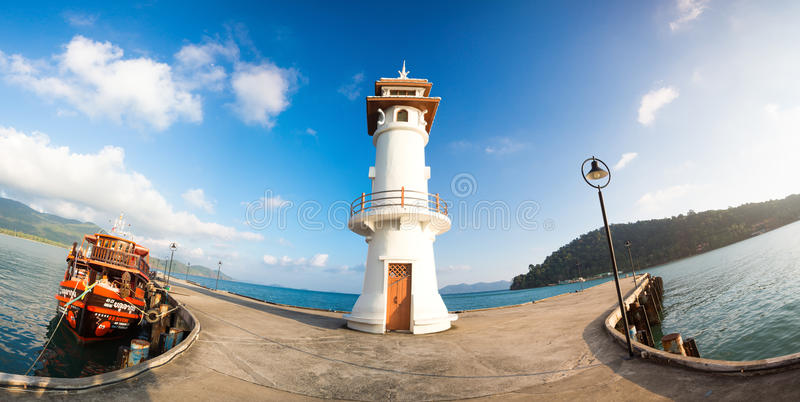 Light house and Pier on Ko Chang Island, Thailand stock photo