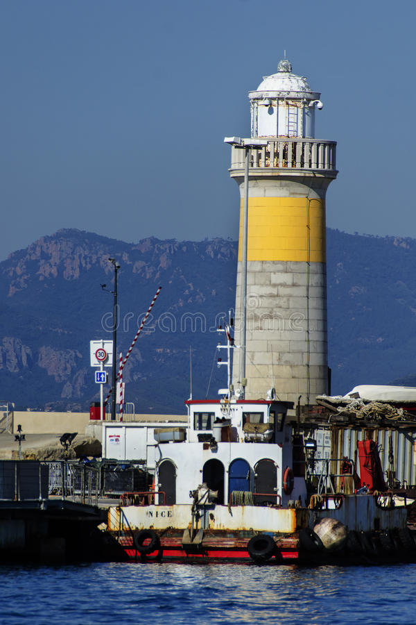 Light house & ship in the port of Cannes stock images