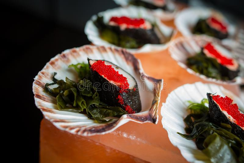 Light Japanese appetizer with caviar of flying fish stock photography