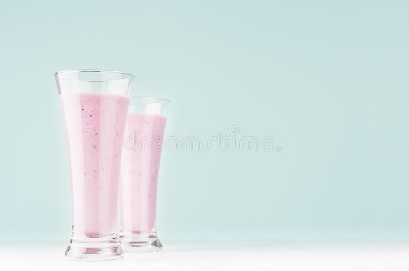 Light joyful spring milk drinks with blueberry on modern pastel mint green color background and white wood table, copy space. stock images