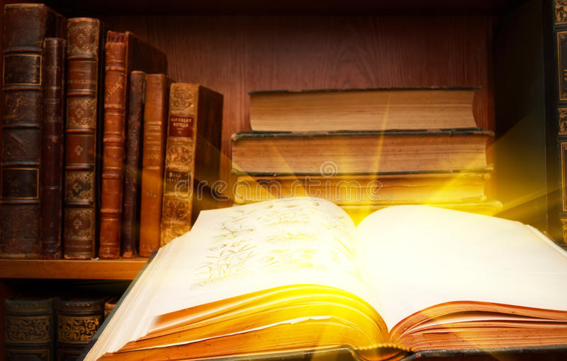 The light of knowledge - in books stock photography