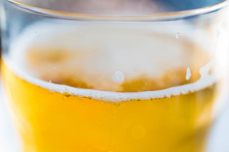 Light lager beer in a glass. Light lager beer in glass close up royalty free stock images