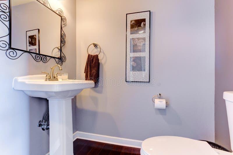 Light lavender small bathroom interior royalty free stock photo