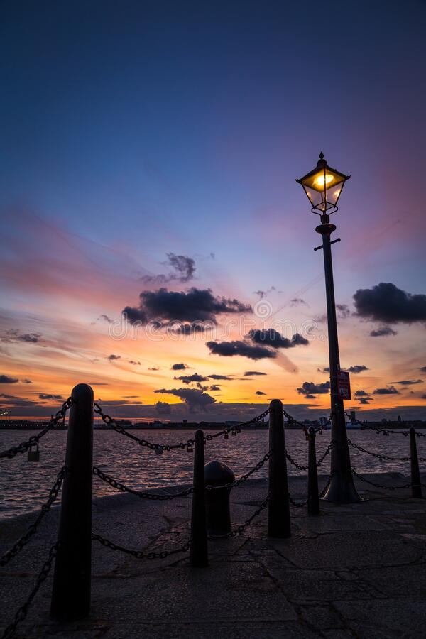 Light on the Liverpool waterfront. As the sun sets over the Wirral royalty free stock image