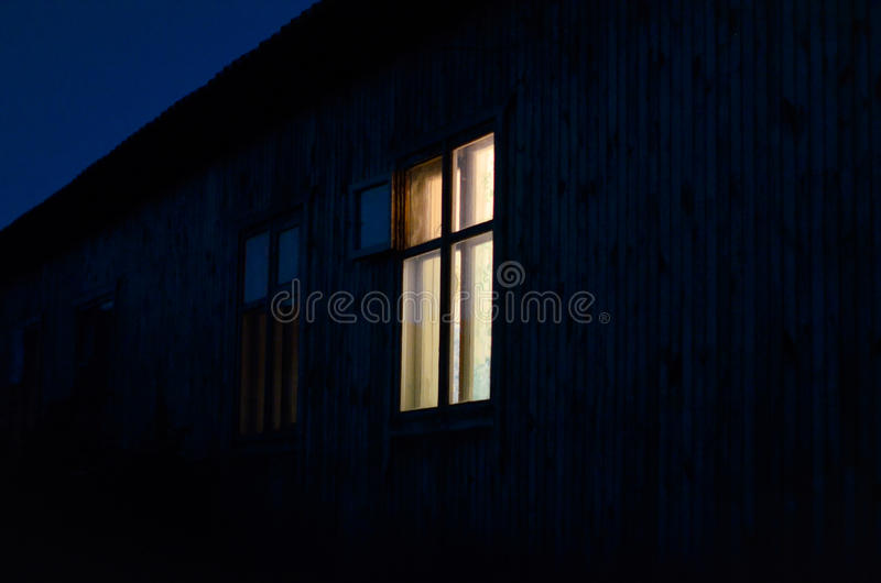 Light in a lone window royalty free stock images
