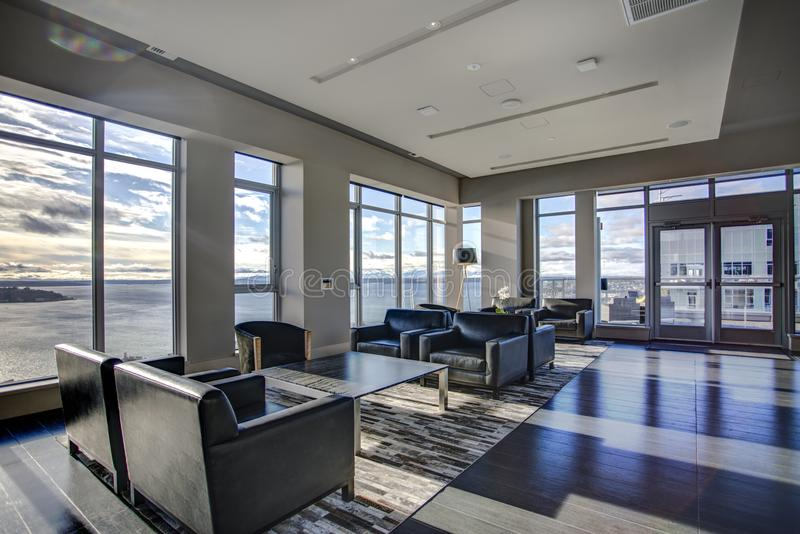 Light lounge area with view of Elliott Bay waters. stock image