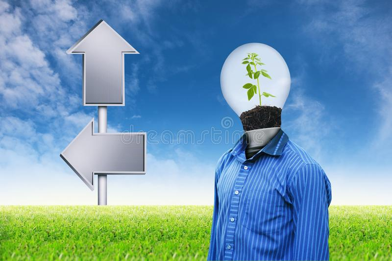 Light man on grass sky background 1. Globe and Light man tree with plant growing on dirt and empty signposts on grass sky background royalty free stock images
