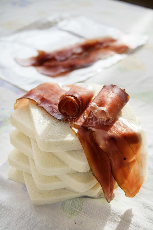 Sandwich with filling of speck or Italian smoked ham stock images