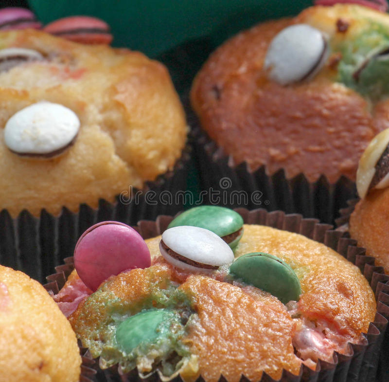 Light muffin with various sweets on top stock photos