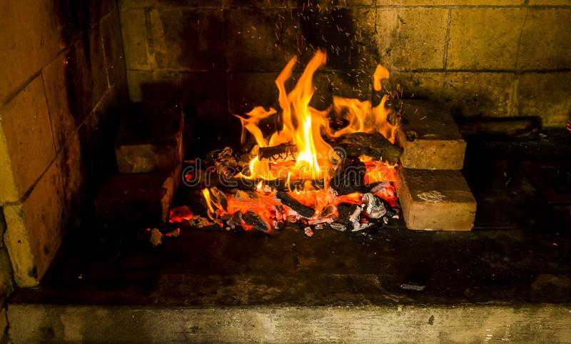 Light my fire. Fire in an oven for a dinner with friends royalty free stock image