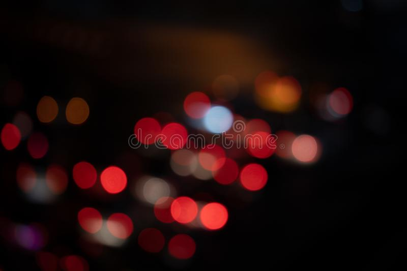 Light night at city blue bokeh abstract black background blur lens flare reflection beautiful circle glitter merry christmas and stock images