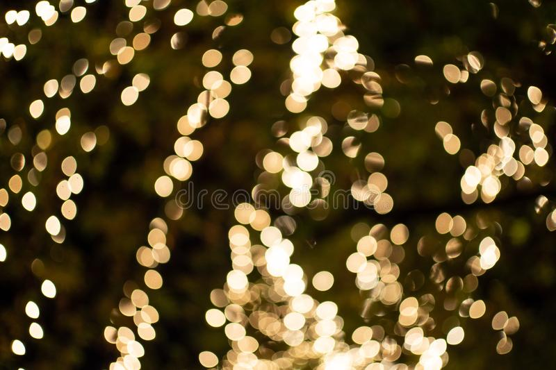 Light night city bokeh abstract background glittering stars on bokeh. Orange bokeh in the bottom of the picture. Has a black royalty free stock photography